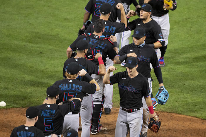 The Miami Marlins celebrate their Opening Day win against the Philadelphia Phillies last week at Citizens Bank Park in Philadelphia.
