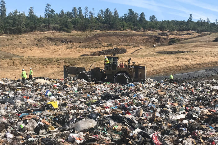 Landfill workers bury all plastic except soda bottles and milk jugs at Rogue Disposal & Recycling in southern Oregon.