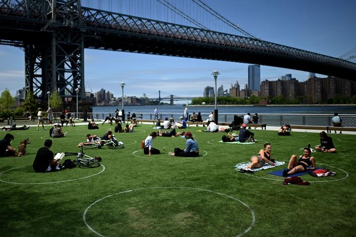 A new study has found that parks in low-income and majority-nonwhite communities are smaller and serve a larger number of people per park acre. People are seen here relaxing in May in Brooklyn's Domino Park.