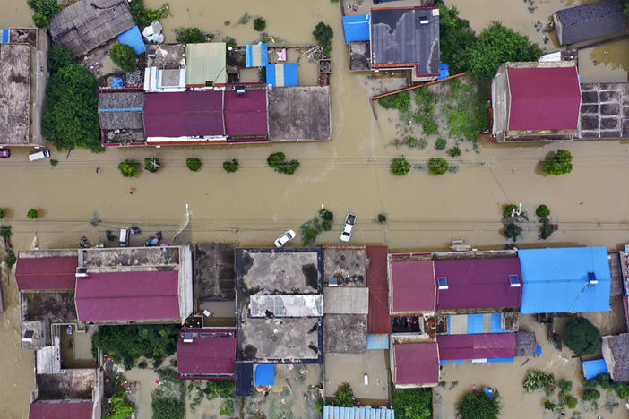 An aerial photo shows the extent of flooding in Guzhen Town of Lu'an City in eastern China's Anhui province on July 20.