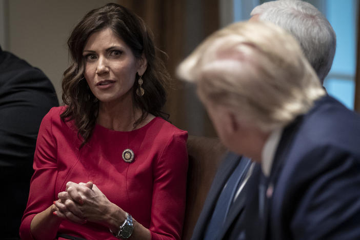 South Dakota Gov. Kristi Noem meets with President Trump and Vice President Pence at the White House in December. This month, she was one of the first governors to reject the president's offer of additional unemployment assistance.