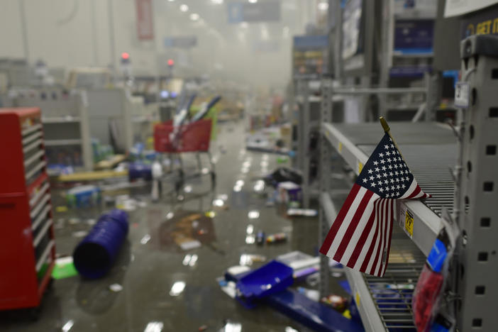 A flag drapes across looted shelves in a hardware store during widespread unrest following the death of George Floyd on May 31, 2020 in Philadelphia, Penn.
