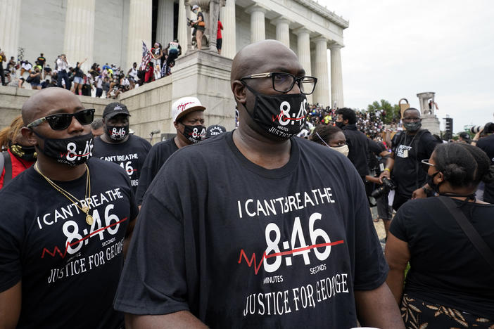 Philonise Floyd, right, brother of George Floyd, gets ready to march from the Lincoln Memorial to the Martin Luther King Jr. Memorial, during the March on Washington on Friday.