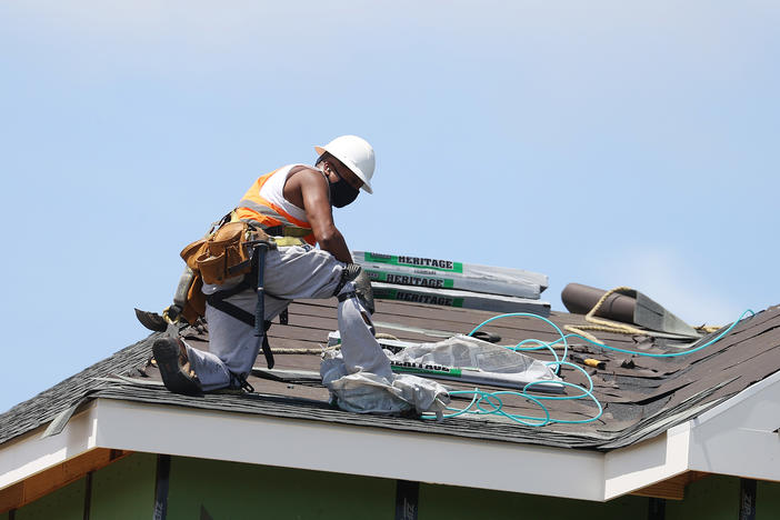 A construction worker roofs an apartment complex in Uniondale, N.Y., on May 27. U.S. employers added fewer jobs last month even as the unemployment rate fell to 8.4%.