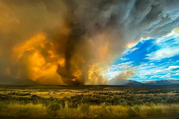 A funnel appears in a thick plume of smoke from the Loyalton Fire last month in Lassen County, Calif. It is one of many wildfires to have hit the state recently.