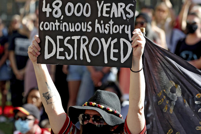 Protesters rallied outside the Rio Tinto office in June in Perth, Australia, after the destruction of Indigenous heritage sites the month before.