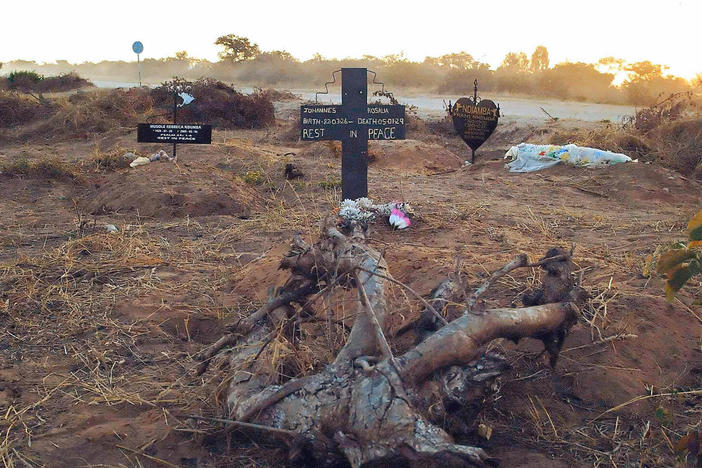 An illegal roadside graveyard in northeastern Namibia. People in the townships surrounding Rundu, a town on the border to Angola, are too poor to afford a funeral plot at the municipal graveyard — and resorted to burying their dead next to a dusty gravel road just outside of the town.