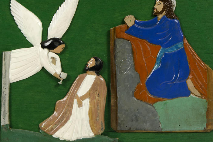 A page from <em>The Book of Wood: Rose of Sharon, Jesus Heals Woman Bleeding, Judas Kiss, Jesus in the Garden of Gethsemane,</em> 1932, paint on carved wood, mounted on wood panels