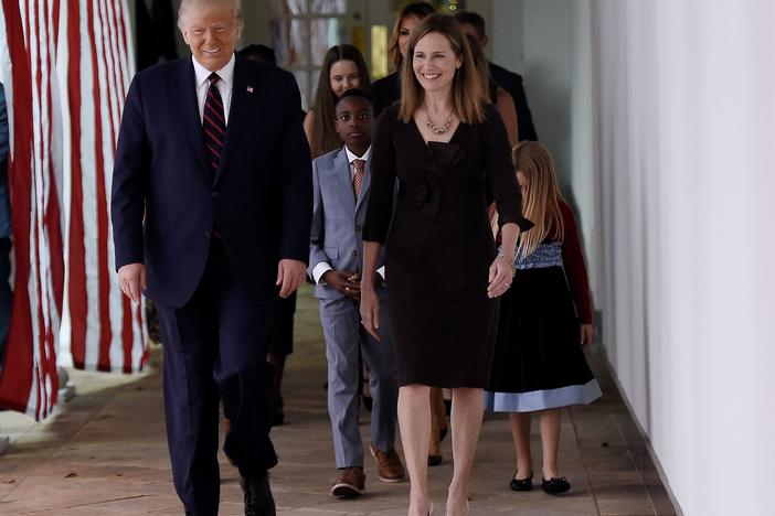 President Trump and Judge Amy Coney Barrett walk to the Rose Garden of the White House on Saturday.
