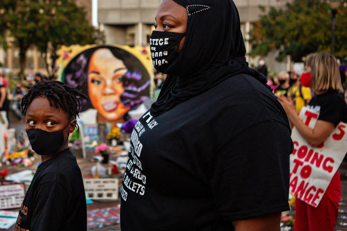 The grand jury recording in the Breonna Taylor case will be released, after a judge ordered the attorney general's office to produce the recording by Wednesday. Here, a mother and son attend a demonstration in what activists are now calling Injustice Square Park in downtown Louisville, as protesters demand justice for Taylor's killing by police.