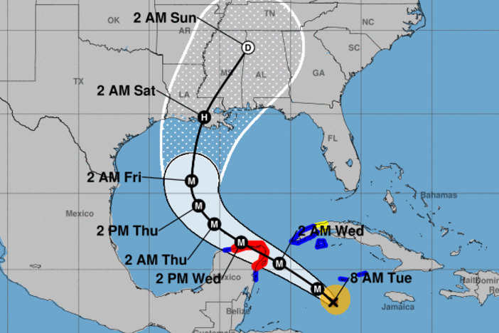 Hurricane Delta will pass over part of the Yucatan Peninsula before heading toward the Gulf Coast, where it's forecast to make landfall on the Louisiana coast late this week.