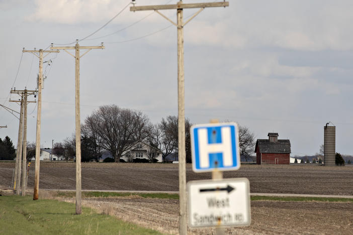 A road sign for a nearby hospital along a rural road outside Sandwich, Ill., in April.