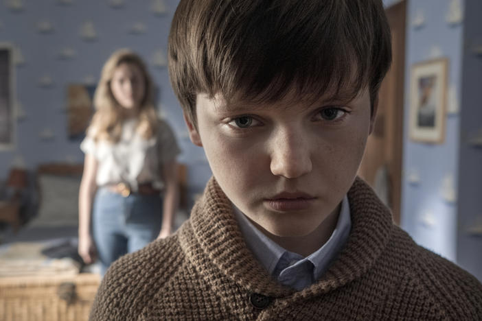 What's creepier: The kid (Benjamin Evan Ainsworth) or the high-waisted jeans on the au pair (Victoria Pedretti)? <em>The Haunting of Bly Manor</em> makes a case for both.