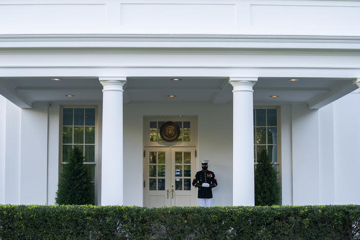 A Marine is posted Thursday outside the West Wing of the White House, signifying the president is in the Oval Office. President Trump's physician said that he could return to public engagements as soon as Saturday.