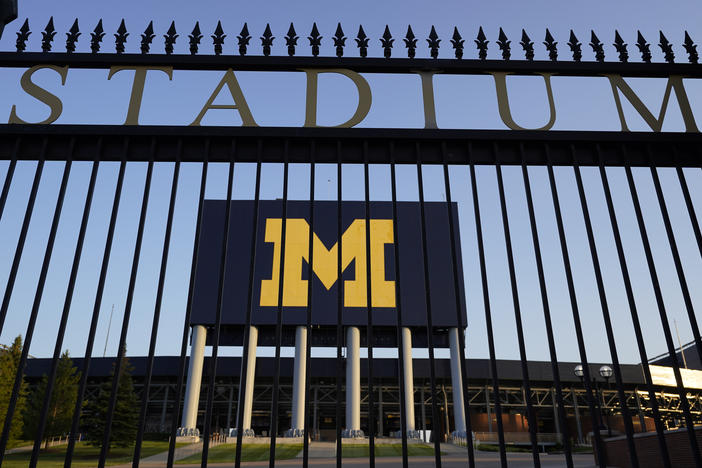 The University of Michigan football stadium is shown in Ann Arbor, Mich., this summer. Health officials in Michigan say infections among university students account for over 60% of local infections.