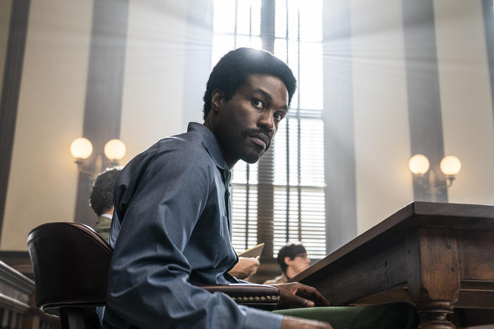 This image released by Netflix shows Yahya Abdul-Mateen II as Bobby Seale in a scene from <em>The Trial of the Chicago 7</em>.