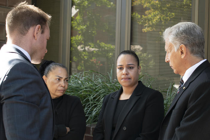 Rulennis Munoz (center right) outside Lancaster Courthouse Oct. 14, after learning that the police officer who fatally shot her brother had been cleared of criminal wrongdoing by the Lancaster County District Attorney. Her mother, Miguelina Peña, and her attorney Michael Perna (far right) stood by.