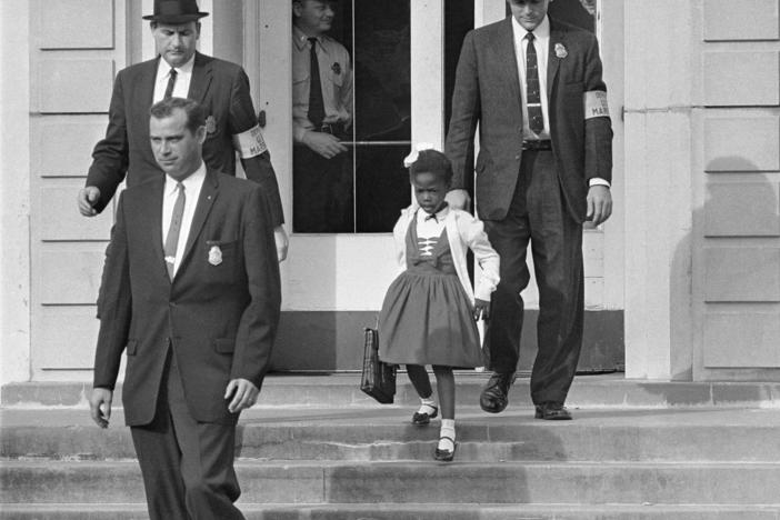 U.S. Deputy Marshals escort 6-year-old Ruby Bridges from William Frantz Elementary School in New Orleans, in this November 1960, file photo. Lucille Bridges, Ruby's mother, died Tuesday at the age of 86.