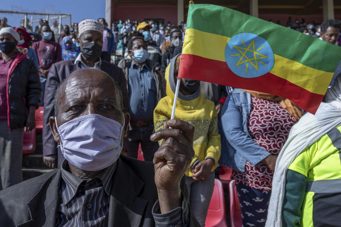 A man holds a national flag as he waits to donate blood in support of Ethiopia's military in Addis Ababa on Thursday. Rallies occurred in multiple cities in support of the government's military offensive against the Tigray People's Liberation Front.