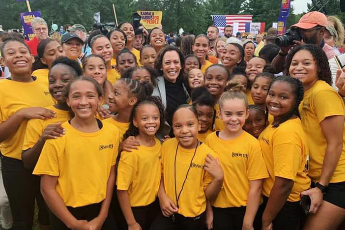 Kamala Harris poses with the Isiserettes, a legendary drill-and-drum team, at the Polk County Steak Fry in Iowa in 2019.