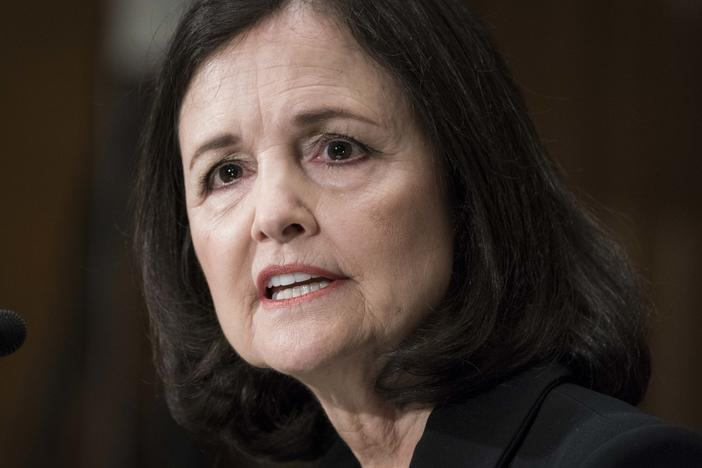 Judy Shelton testifies before the Senate Banking, Housing and Urban Affairs Committee during a February hearing on her nomination to the Federal Reserve's board of governors. A slim majority in the Senate is expected to confirm Shelton this week.