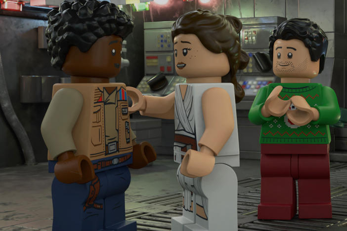 """Now THAT's fan-servicing!': L to R: LEGO Finn, LEGO Rey, LEGO Poe, LEGO Rose and LEGO Chewie plan a Life Day party in <em>The LEGO Star Wars Holiday Special.</em>"
