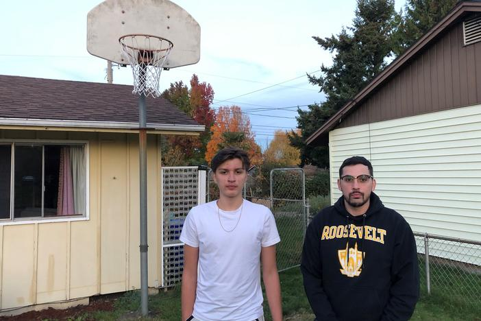 Antonio Jimenez (L) and his father Antonio Garcia at their home in Portland, Ore. Jimenez, a 16-year-old high school junior, has been trying to develop his basketball skills during the pandemic by training in small groups with other players and shooting several hundred jump shots daily at home.