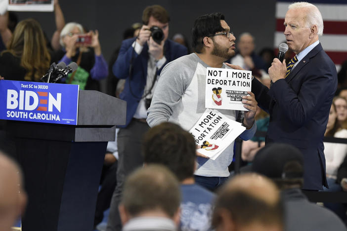 While campaigning in November 2019, Joe Biden talked with a protester about his stance on deportations at a town hall at Lander University in Greenwood, S.C. The Biden administration says it will rein in Immigration and Customs Enforcement, starting with a temporary moratorium on deportations.
