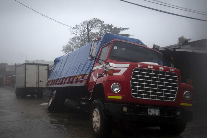 A truck flounders in a flooded street in Puerto Cabezas, Nicaragua, just hours before Hurricane Iota made landfall in the country Monday night. By Tuesday morning, the storm had significantly weakened, but it still poses life-threatening dangers for residents in its path.