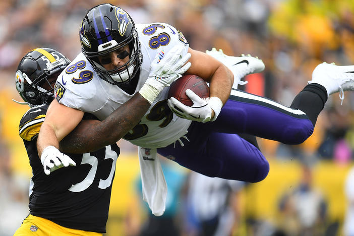 Mark Andrews, right, of the Baltimore Ravens hurdles Devin Bush, left, of the Pittsburgh Steelers during the first quarter at Heinz Field on Oct. 6, 2019 in Pittsburgh. This season, the Thanksgiving matchup between the two teams has been canceled due to a coronavirus outbreak.