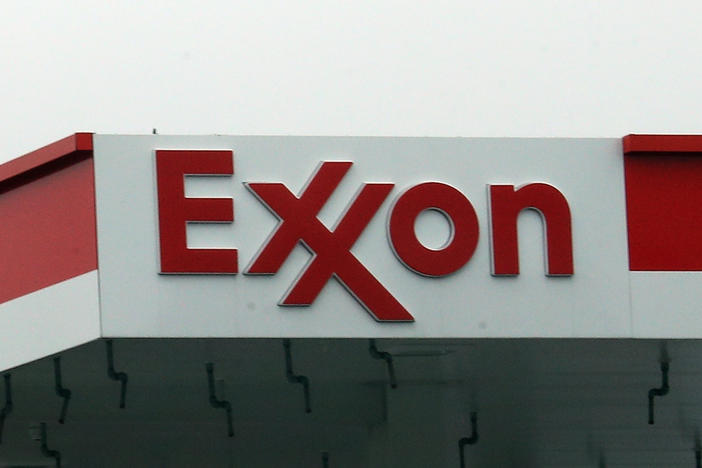 An Exxon station in Hicksville, N.Y., is shown on March 20, 2020. ExxonMobil announced up to $20 billion in write-downs of natural gas assets, the biggest such action ever by the company.