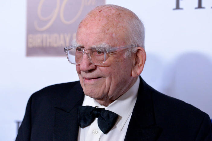 Ed Asner and nine other actors have filed an age discrimination suit over changes to the SAG-AFTRA union's health plan.