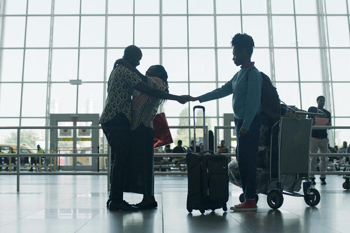 After a 17-year separation, Walter (Ntare Guma Mbaho Mwine) greets his wife Esther (Zainab Jah) and daughter Sylvia (Ekwa Msangi) at JFK airport in the opening scene of <em>Farewell Amor. </em>