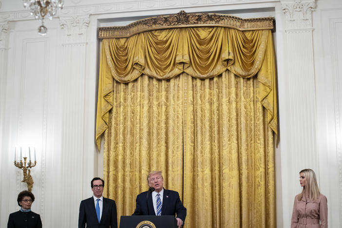 President Trump speaks in April about the Paycheck Protection Program. From left are Jovita Carranza, head of the Small Business Administration; Treasury Secretary Steven Mnuchin; and adviser Ivanka Trump.