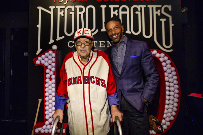 Negro Leagues baseball veteran Jim Robinson and ESPN/ABC correspondent Ryan Smith attend an event celebrating 100th anniversary of the league in New York in February.
