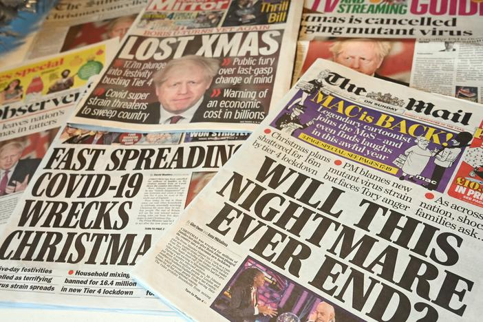 "An arrangement of U.K. daily newspapers shows front page headlines reporting on the tight new coronavirus restrictions for London and the southeast of England, cancelling Christmas gatherings for those in the new ""Tier 4"" category."