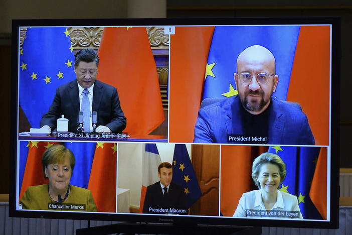 A screen displays Chinese President Xi Jinping (top left), European Council President Charles Michel (top right), European Commission President Ursula von der Leyen (bottom right), French President Emmanuel Macron and German Chancellor Angela Merkel during an EU-China Leaders' meeting video conference Wednesday.