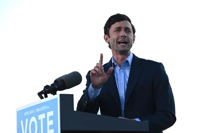Democrat Jon Ossoff speaks at a rally outside of Center Parc Stadium in Atlanta on Monday.