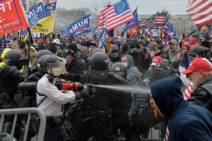 Trump supporters clash with police and security forces as they try to storm the Capitol in Washington, D.C. on Wednesday. Demonstrators breached security and entered the Capitol as Congress debated the 2020 electoral vote certification.