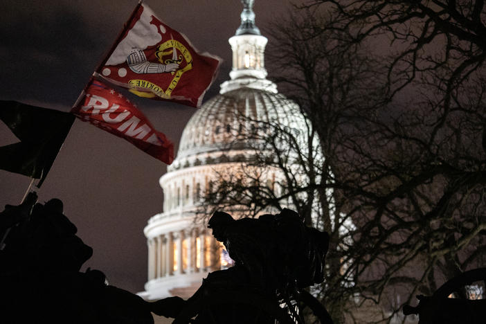 A Trump flag flies over the grounds of the U.S. Capitol on Wednesday after a mob stormed the building, breaking windows and clashing with police officers.