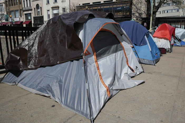 Tents of homeless people line a street in Washington, D.C., in April.