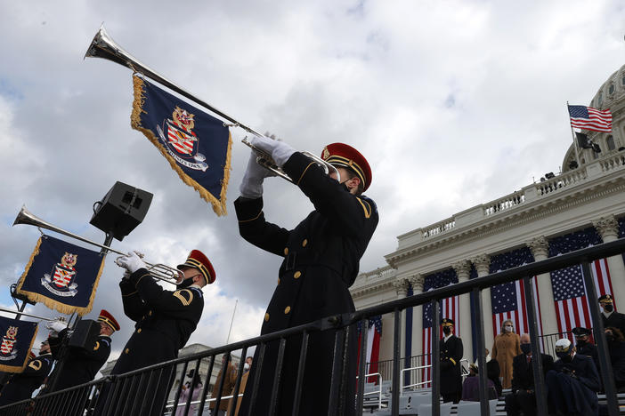 "The U.S. Army Band plays ""Pershing's Own"" during the inauguration. Leaders, former officials and citizens expressed optimism with the dawn of the new U.S. administration."