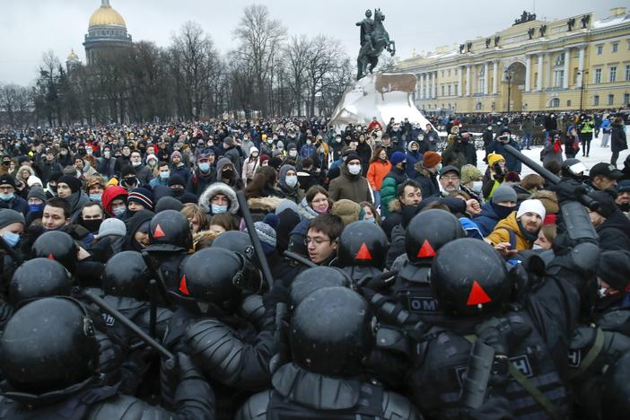 People clash with police Saturday during a protest in St. Petersburg, Russia, against the jailing of opposition leader Alexei Navalny.