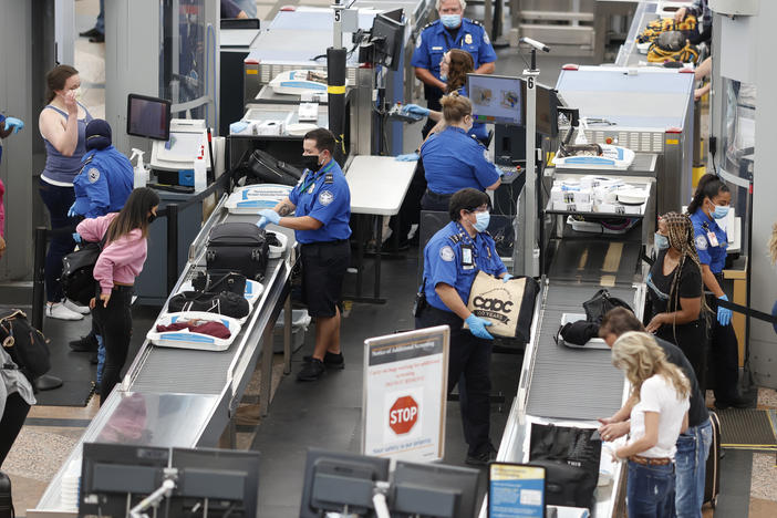 TSA agents clearing passengers at Denver International Airport, June 2020. TSA found twice as many weapons on passengers per million in 2020 than they did the year prior.