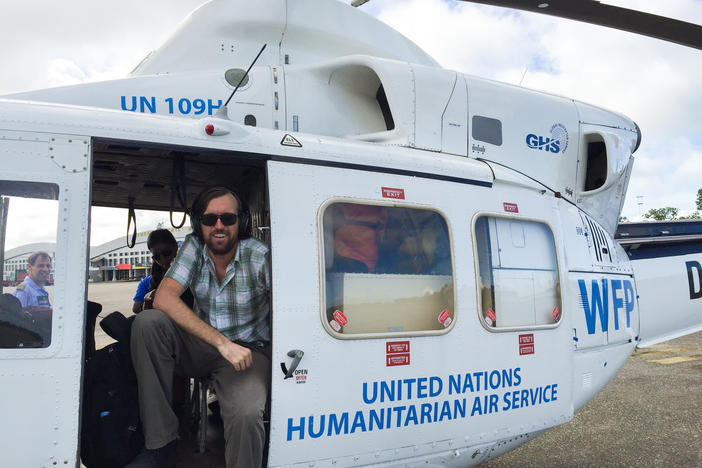 Dr. Eugene Richardson in a helicopter during the Ebola outbreak in Sierra Leone, where he worked as a clinical lead for Partner in Health's response to the outbreak. He is the author of the new book <em>Epidemic Illusions: On the Coloniality of Global Public Health.</em>