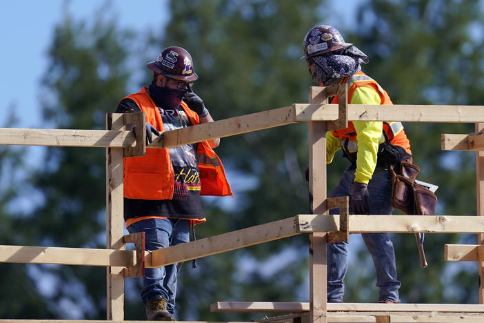 Construction workers are on the job in Simi Valley, Calif., earlier this week. Nationally, hiring resumed in January although the labor market still has a big hole to climb out of.