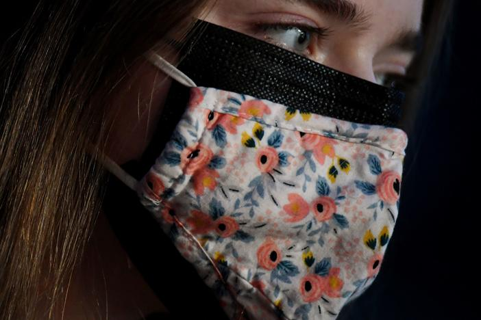 As new, more transmissible variants of the coronavirus spread, the CDC says wearing a cloth mask over a surgical mask offers increased protection against the virus.
