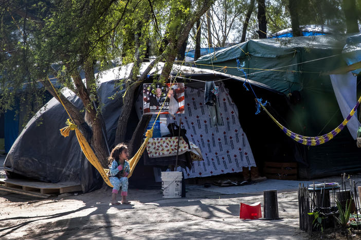 A Salvadoran girl sits inside a camp for asylum-seekers on Sunday in Matamoros, Mexico, where some 600 people who left Central America have been waiting for immigration court hearings.
