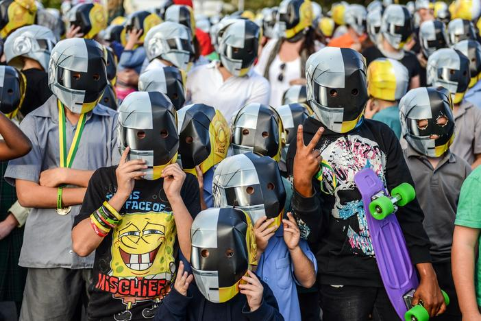 Fans photographed on the eve of Daft Punk's album launch, held in the tiny Australian town of Wee Waa, on May 17, 2013.