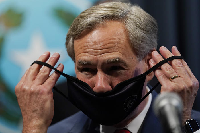 Texas Gov. Greg Abbott, seen here donning a mask in September, announced Tuesday he will lift the state's mask mandate.